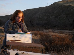 Writing on a mailbox desk by Julie Jordan Scott