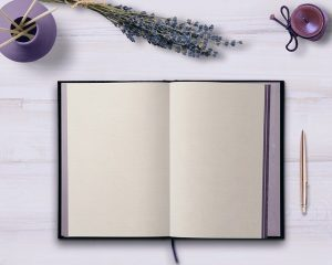 Blank-open-notebook- on -table -with-pen-and-lavender