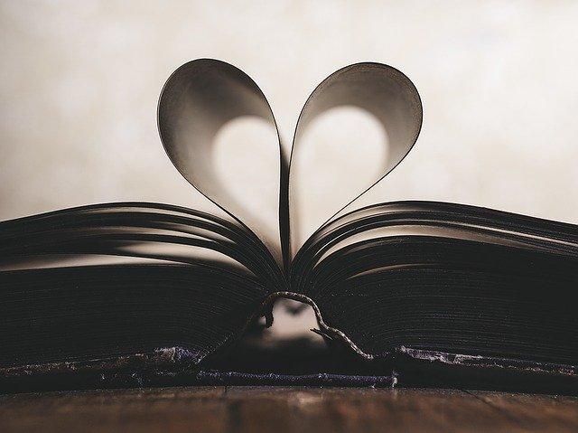 heart-shape-formed-by-central-pages-of-a-book