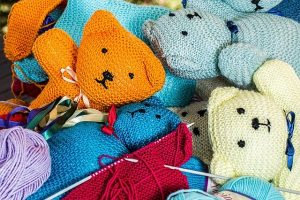 Brightly coloured knitted teddies