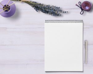 notepad-lavender-candle-table