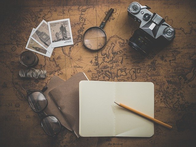 notebook-old-photos-magnifying-glass-camera